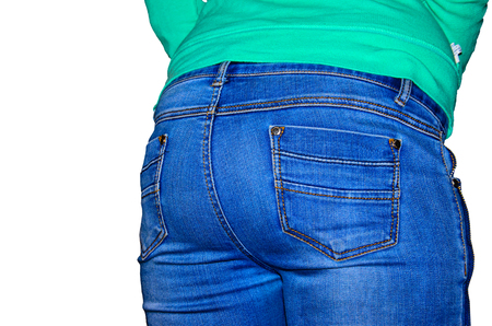 butt tight jeans: Rear view of the young woman wearing blue jeans