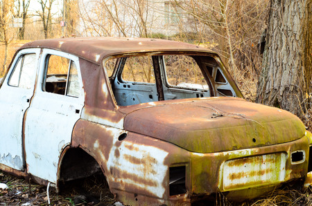 oldie: Old rusty car body on a ground Stock Photo