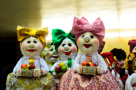 Handmade rag dolls with the bows on a market