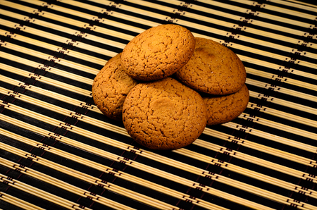 Oatmeal cookies with honey on the bamboo mat Stock Photo