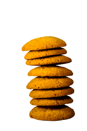 Pile of the honey cookies isolated on a white background