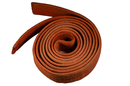 Martial arts orange belt isolated on a white background