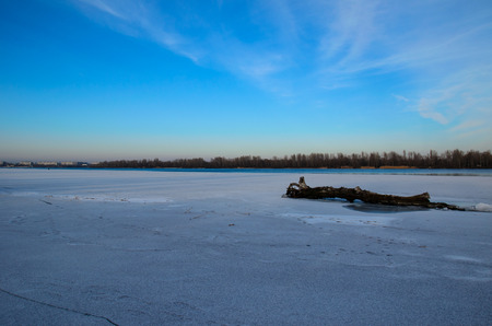 yule log: Log on a bank of the frozen river Dnieper