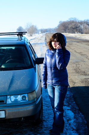 call for help: Young woman call for help near the broken car on roadside