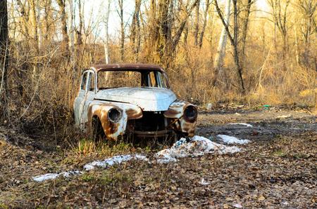 rusty car: Old rusty car body on a ground Stock Photo