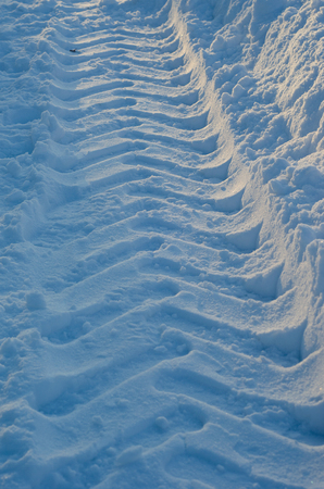 Tire tracks in a white fluffy snow