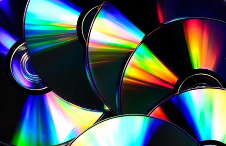 Pila de los discos de cd para el fondo