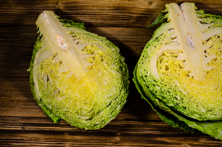 Quarters of the savoy cabbage on wooden table