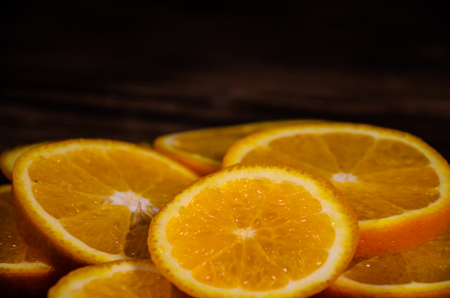 Slices of the orange on wooden table Stock Photo