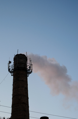 Industrial pipe and smoke against the sky. Environmental pollution Stock Photo