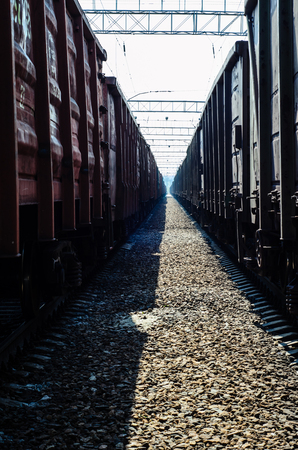 View between two cargo trains on cloudy day Stock Photo