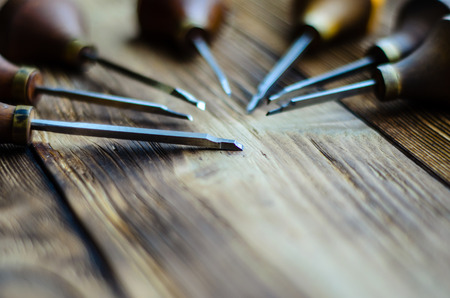alloy: Different gravers for jewelry on a wooden background Stock Photo