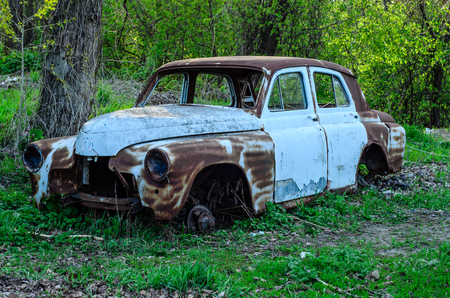 Old rusty car body on a ground Stock Photo