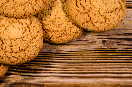 Stack of the oatmeal cookies on rustic wooden table