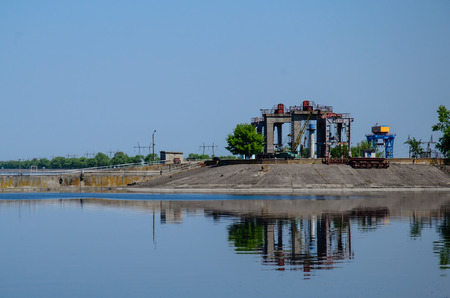 Buildings of the hydraulic power plant on lake Stock Photo
