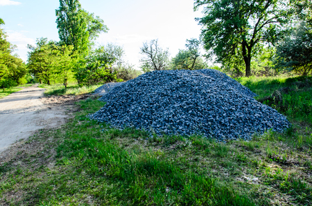 Pile of the gravel on green grass Stock Photo