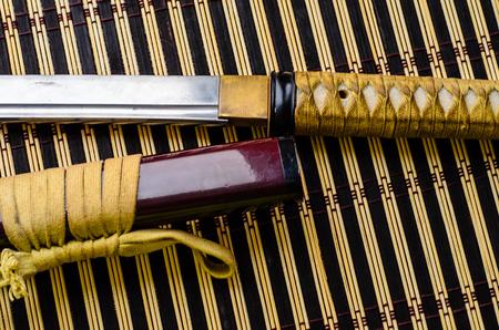 bushido: Japanese sword katana on a bamboo mat Stock Photo