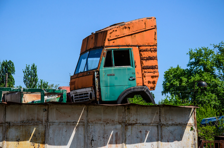 Old cab of the truck on a roof of garage