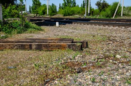 wood railways: Old wooden sleepers near the new railroad track
