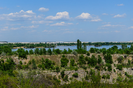 riverside trees: View on city Komsomolsk and river Dnieper Stock Photo