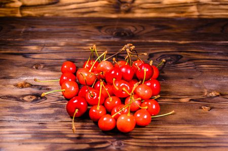 Fresh ripe cherries on rustic wooden table Stock Photo