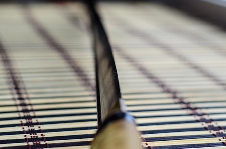 sheath: Japanese sword katana on a bamboo mat. Selective focus