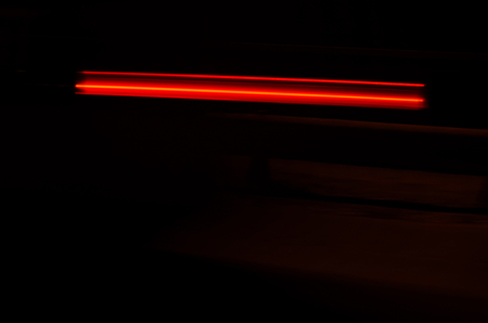 street lamp: Trails of the car lights on night road Stock Photo