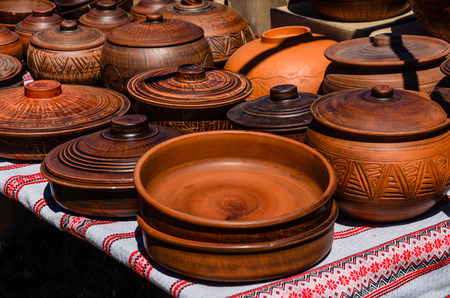 Different wooden pots for sale on a peasant fair