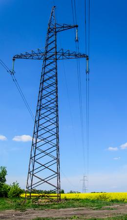 power: High voltage power line against blue sky