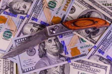 criminal: Flick knife on one hundred dollar bills