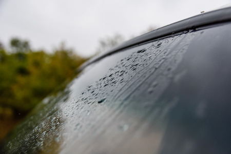 Rain drops on a windscreen of the car Stock Photo