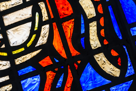 Abstract colorful stained glass window in city hall