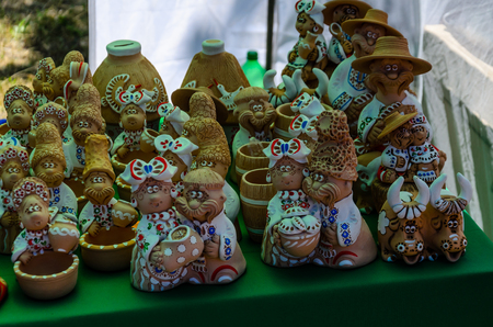 Different Ukrainian figurines for sale on street fair