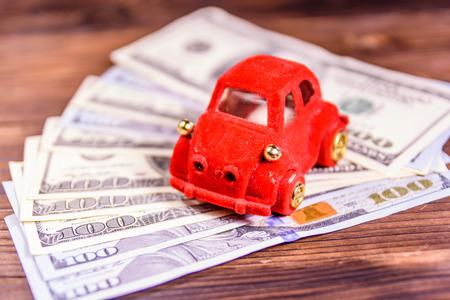 Toy car on one hundred dollar bills