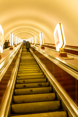 View on escalator in the metro. Moving up staircase