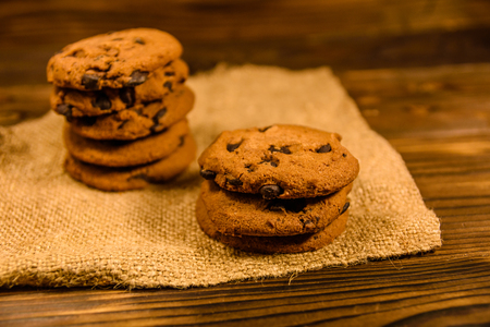 Chocolate chip cookies on a sackcloth on wooden table Stock Photo