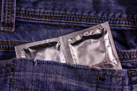 Condoms in a pocket of blue jeans