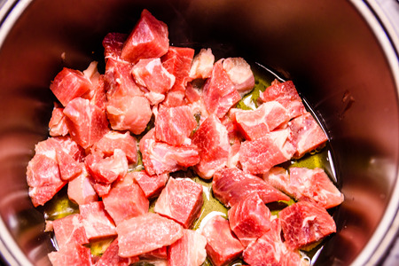 Pork meat preparing in the slow cooker