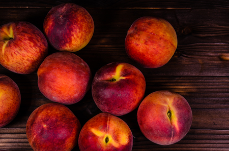 Fresh ripe peaches on rustic wooden table. Top view Stock Photo