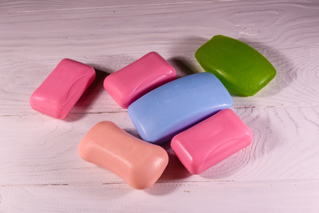 Pieces of soap on white wooden table 版權商用圖片