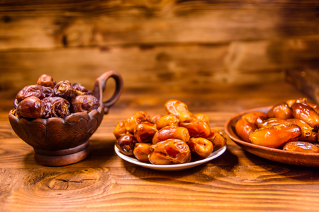 Date fruits on a rustic wooden table Stock Photo