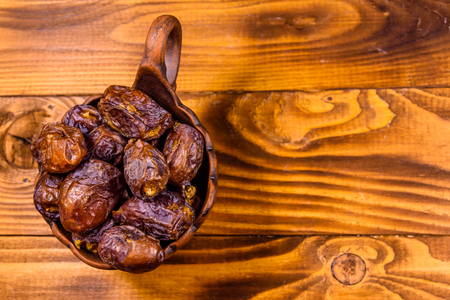 Date fruits on rustic wooden table. Top view