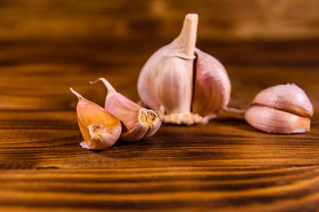Ripe fresh garlic on rustic wooden table