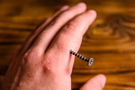 Human arm injured with the metal screw