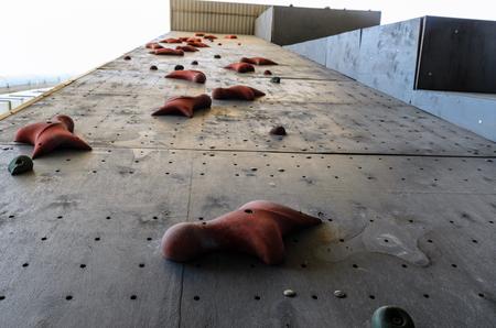 Hand hooks on empty artificial climbing wall Stok Fotoğraf