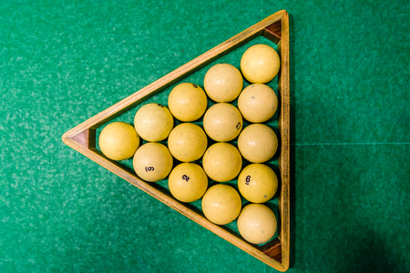 Triangle of balls on a green cloth. Russian billiard. Top view 스톡 콘텐츠