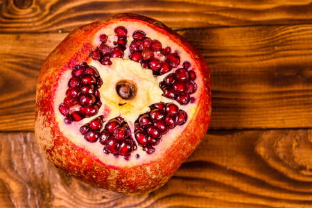 Fresh ripe garnet fruit on rustic wooden table. Top view