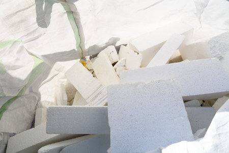 Heap of polystyrene pieces in polyethylene bag Stock Photo