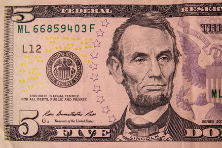 Closeup of the american five dollars banknote