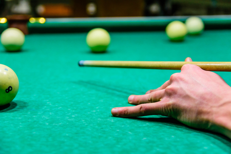 Player arm with the cue and balls on a green cloth. Russian billiard 스톡 콘텐츠